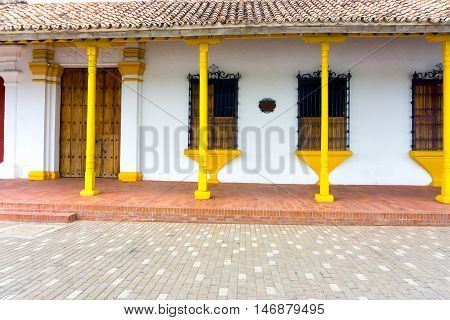 Beautiful yellow and white colonial architecture in Mompox Colombia
