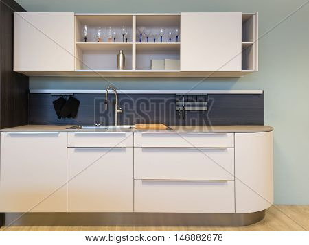 nice small beige kitchen kitchenet with sink and wall unit