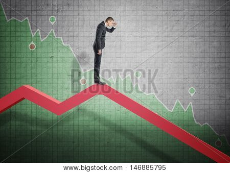 Businessman standing on falling diagram and peering into the future on the background of stock market selloff. Economic crisis. Bankruptcy and money devaluation. poster