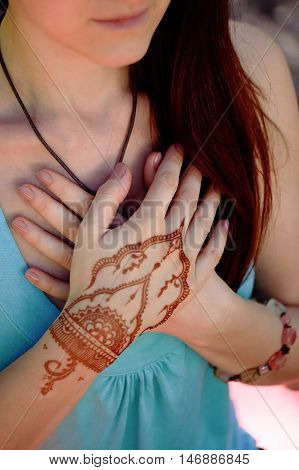 Hand yoga with brown henna mehendi. Harmony and tranquility