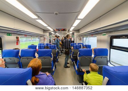 Passengers In The Car Of A Passenger Train.
