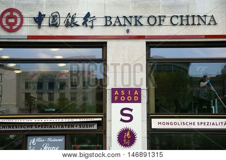 MAINZ, GERMANY - JULY 14: The showcases of Asian specialty restaurants and the Bank of China on the Potsdam Square on June 21, 2016 in Berlin.