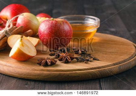 Apple tart ingredients on wood table with honey