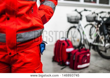 emergency volunteer operator with medical devices and emergency bags