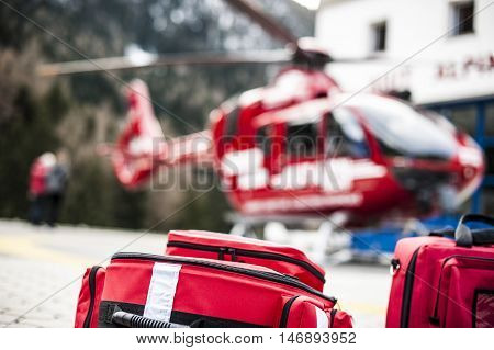 emergency bags and rucksacks near a rescue helicopter