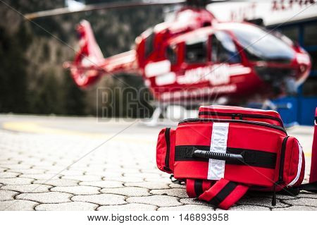 emergency rucksack with medical devices near a rescue helicopter