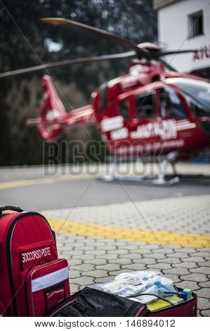 emergency bag and rucksack with medical devices and a rescue helicopter