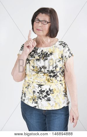 Attractive Elderly Woman Threatens With A Finger..