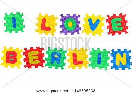 Message I Love Berlin from letters puzzle isolated on white background.