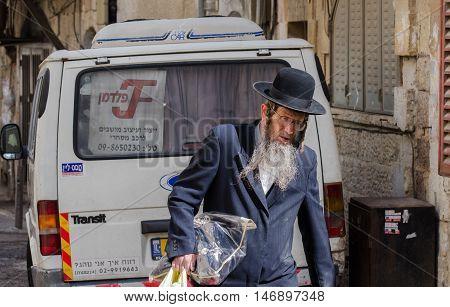 JERUSALEM ISRAEL - MARCH 30 2012: Orthodox Jewish man walk in jewish quarter. Jerusalem. Israel