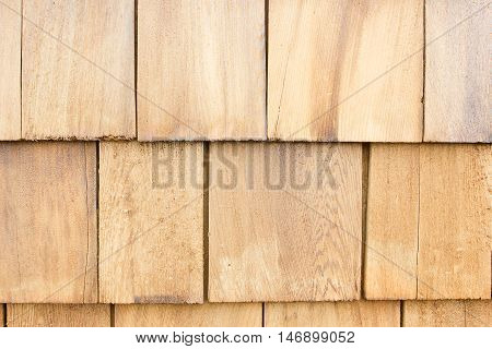 Close up of brown wood roof shingles.Wood background.