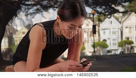 Asian Woman Resting After Long Run Outdoors