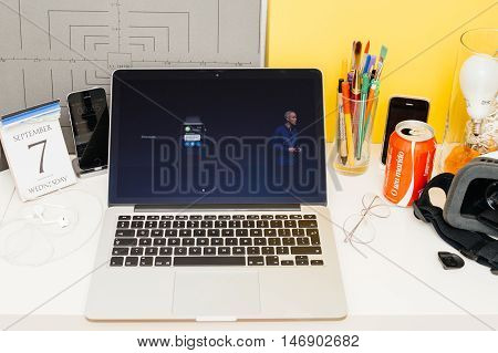 PARIS FRANCE - SEP 8 2016: Apple Computers website on MacBook Retina in room environment showcasing live coverage of Apple Keynote - Apple COO Jeff Williams about new Apple Watch and messages app