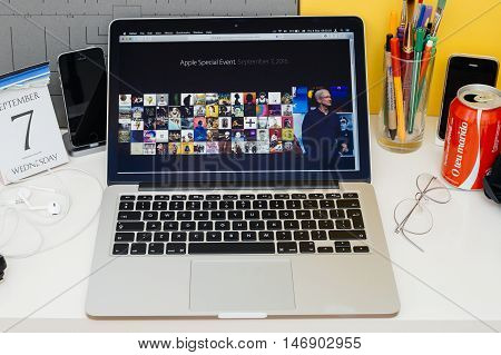 PARIS FRANCE - SEP 8 2016: Apple Computers website on MacBook Retina in room environment showcasing live coverage of Apple Keynote - Tim Cook talking about Apple Music Festival