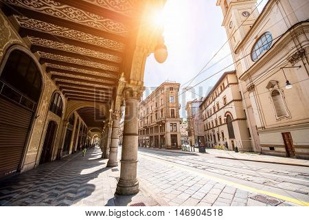Turin, Italy - June 12, 2016: Street view with arch gallery and beautiful buildings in the center of Turin old town in Piedmont region in Italy