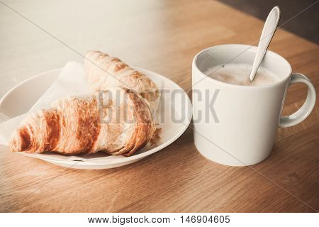 Cappuccino With Croissant. Vintage Stylized Photo