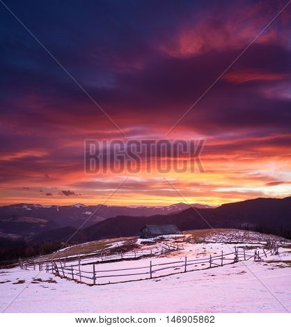 Spring landscape. Colorful sunrise in a mountain village. Sky with beautiful clouds. Carpathians, Ukraine, Europe