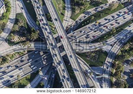 Los Angeles, California, USA - August 6, 2016:  Afternoon aerial view Los Angeles Harbor 110 and Hollywood 101 freeway interchange traffic.