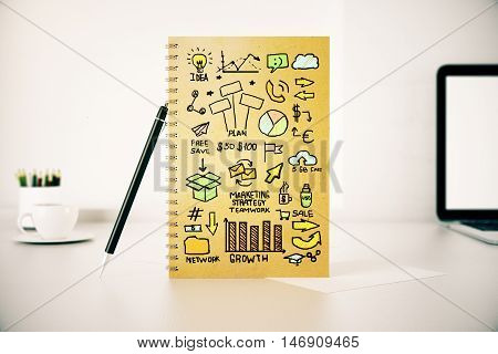 Closeup of workplace with business marketing doodles in spiral notepadm pen coffee cup laptop and other items. 3D Rendering