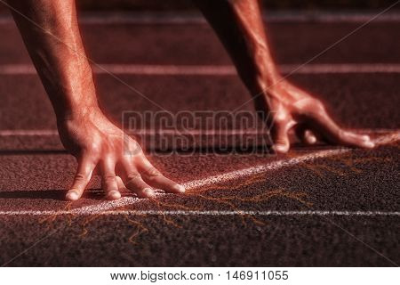 Sport. Unrecognizable runner on the starting -- selective focus and light effects poster