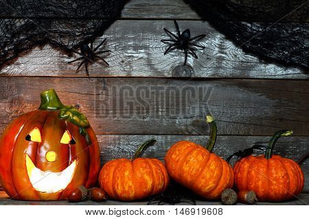 Halloween Jack O Lantern Lit At Night With Pumpkin Bottom Border Against A Rustic Old Wood Backgroun