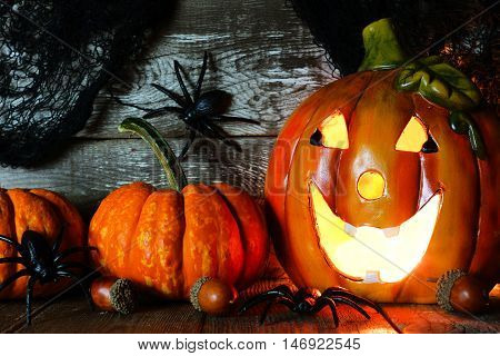 Halloween Jack O Lantern And Pumpkins, Night Scene Against An Old Wood Background