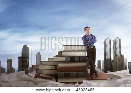 Asian Nerd Man Leaning On The Big Books
