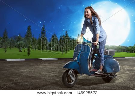 Asian Woman Riding Scooter