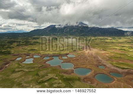 Uzon Caldera in Kronotsky Nature Reserve on Kamchatka Peninsula. View from helicopter.