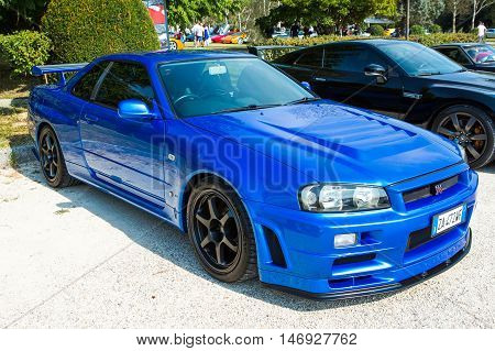 Mogliano VenetoItaly Sept 112016:Photo of a Nissan Skyline GT-R R34. The Nissan GT-R is a 2-door 2+2 sports car produced by Nissan V·spec models were released in January 1999.
