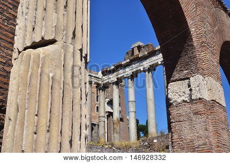 Temple of Saturn viewed through Basilica Julia arches in Roman Forum