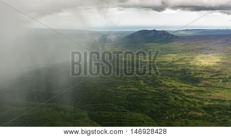 Rain in the Kronotsky Nature Reserve on Kamchatka Peninsula. View from helicopter.