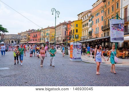 VERONA, ITALY - JULY, 2, 2016: CROWD OF TOURISTS ON A STREETS OF VERONA - ONE OF THE MOST BEAUTIFUL ITALIAN CITIES