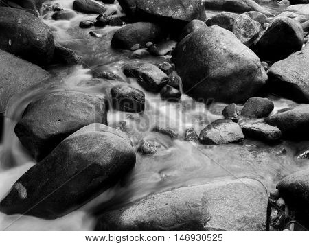 Stream with big rocks in black and white