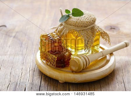 natural organic honey, honeycombs on a wooden table