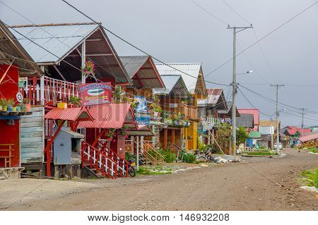 PASTO, COLOMBIA - JULY 3, 2016: some nice and colorfull wood houses with tin roof on the shore of lago la cocha.