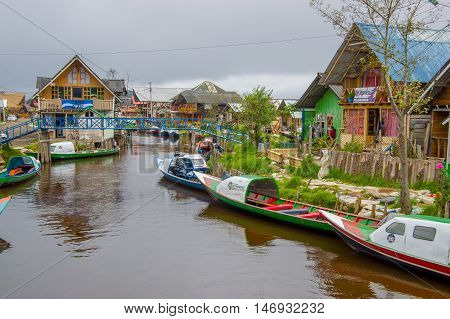 PASTO, COLOMBIA - JULY 3, 2016: some boats parked on the river close to la cocha lake.
