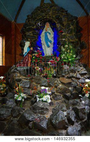 PASTO, COLOMBIA - JULY 3, 2016: statue of the virgin inside a chapel located on la cocha lake.