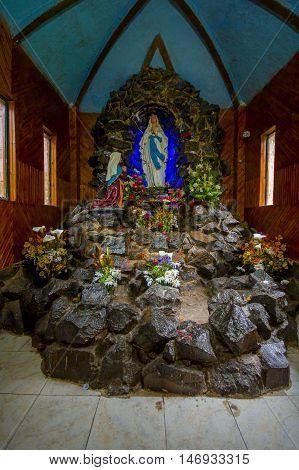 PASTO, COLOMBIA - JULY 3, 2016: virgen de lourdes it is located in a small sanctuary in la cocha lake near to the city of pasto.