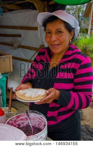 PASTO, COLOMBIA - JULY 3, 2016: unidentified woman from a location close to la cocha preparing a dessert.