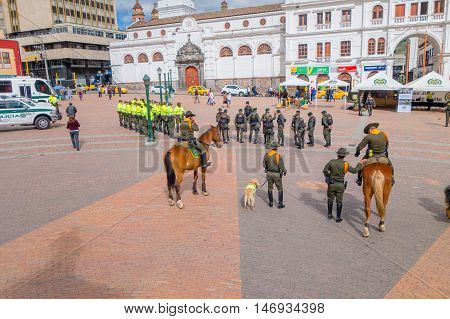PASTO, COLOMBIA - JULY 3, 2016: some policeman standing in the central square preparing an exhibition.