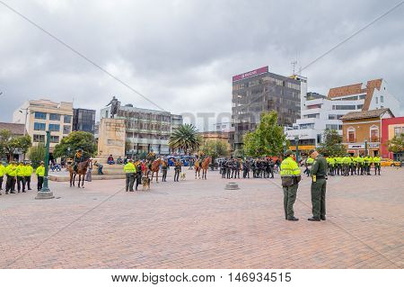 PASTO, COLOMBIA - JULY 3, 2016: some policeman standing in the center square preparing an exhibition.