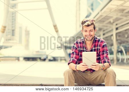 Young Man Using Browsing Tablet Concept
