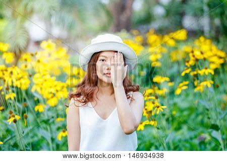 close up portrait of young asian women close her eyes buy her hands bright colors positive emotions cheerful youth concept.