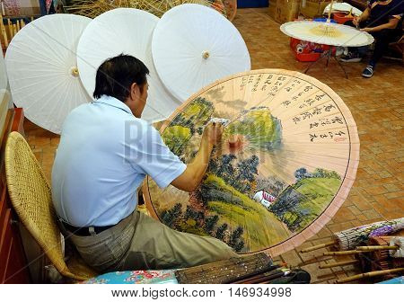 Painting Chinese Oil-paper Umbrellas