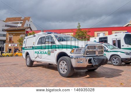 PASTO, COLOMBIA - JULY 3, 2016: white and green police pickup parked next to some othe police vehicles.