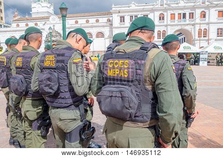 PASTO, COLOMBIA - JULY 3, 2016: police wearing uniform and lifejackets standing on the central square of the city.