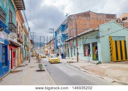 PASTO, COLOMBIA - JULY 3, 2016: some taxis driving through the street in the city center.