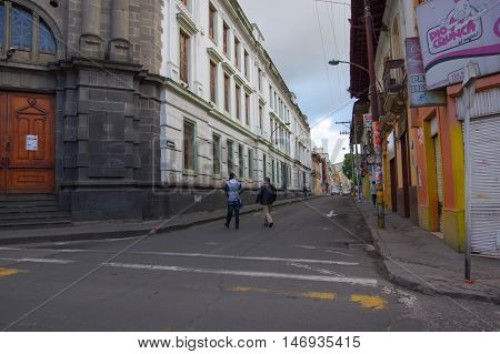 PASTO, COLOMBIA - JULY 3, 2016: pedestrians crossing a street in the city center.