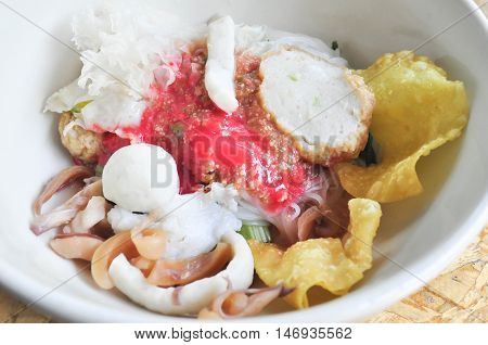 Yong Tau Fu Chinese noodle or Flat noodles with fish ball in red sauce dish